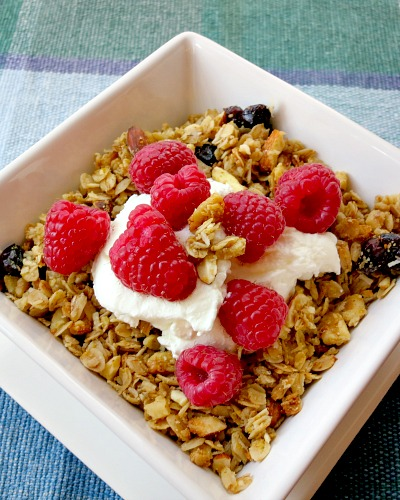Orange Cranberry Granola with Greek yogurt and raspberries