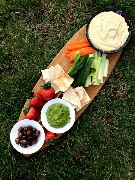 Snack Plate with Hummus, Ramp Pesto, Pita, Berries, Olives and Veggies
