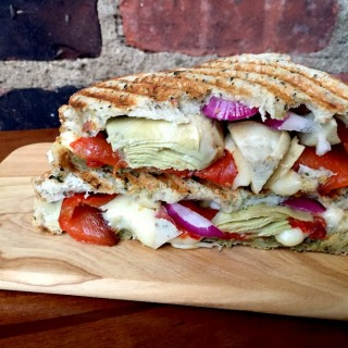 The Ultimate Italian Panini. This healthy and mouth watering sandwich is packed with artichokes, pesto, mozzarella, roasted red bell peppers and red onions.