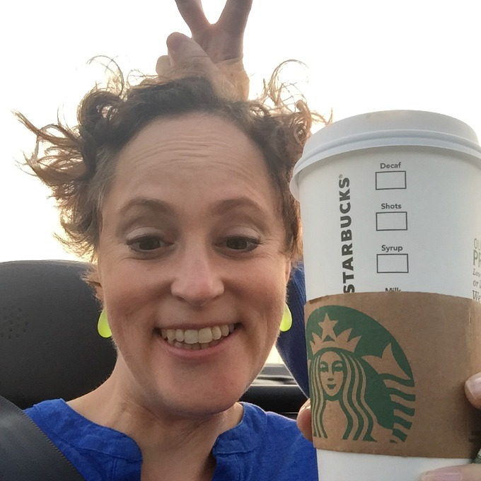 Meg Selfie in Convertible Car with Bunny Ears and Starbucks