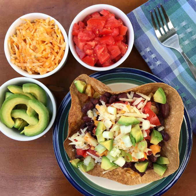 This quick, easy and spicy vegetarian Taco Salad combines cabbage, corn and beans makes for a mouth watering medley of flavors.