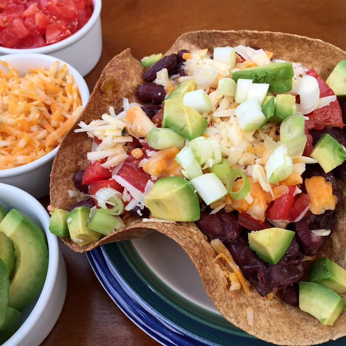 This quick, easy and spicy Vegetarian Taco Salad combines cabbage, corn and beans and makes for a mouth watering medley of flavors.