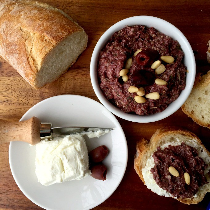 This Mediterranean spread, with Kalamata Olives as the star and artichokes as a close second, is a party in your mouth. Paired with tangy goat cheese and a light and crusty loaf of warm French bread, it's sure to be a success.