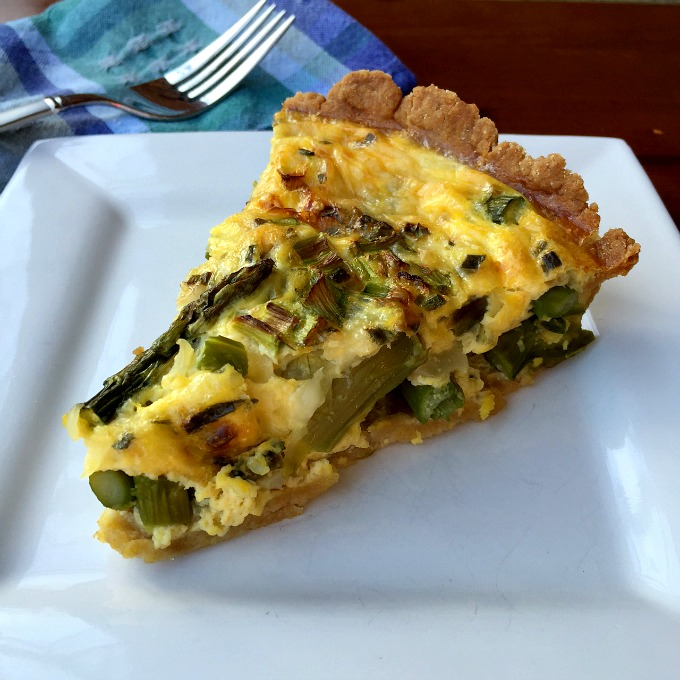 Asparagus, Asiago cheese and spring onions are the perfect match in this super simple quiche recipe.