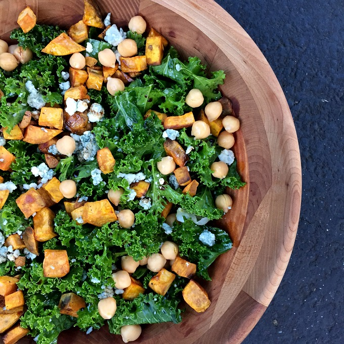 Garlic roasted sweet potatoes, tangy blue cheese and protein packed chickpeas combine with massaged kale to make one super sassy and satisfying salad.