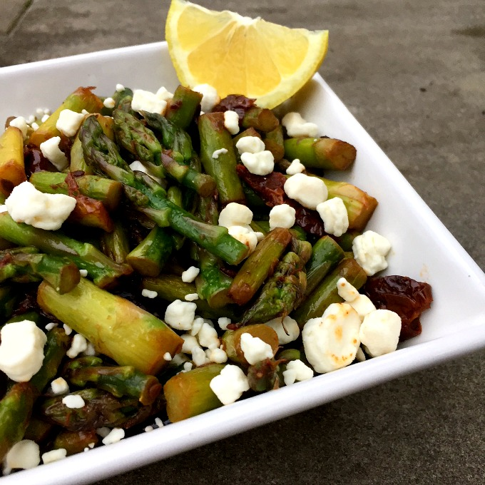 This sauteed asparagus is bursting with flavor thanks to the salty kalamata olives, sweet sun-dried tomatoes, and tangy goat cheese. It's a musical medley in your mouth.
